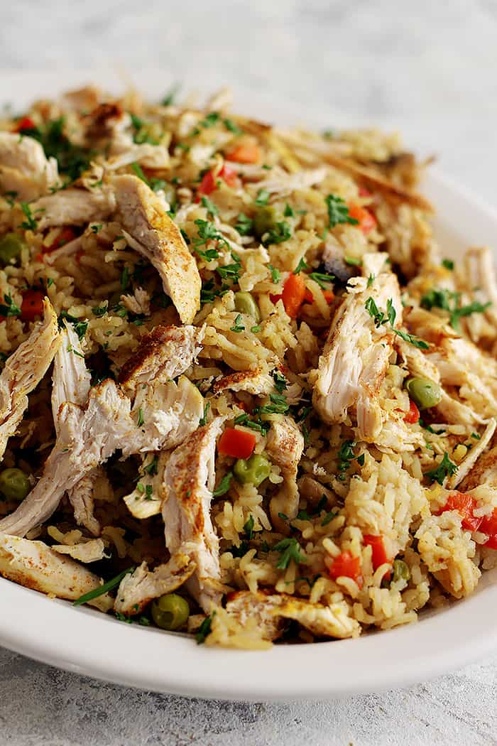 Chicken is shredded and then added to the rice. You can also serve the chicken as it is.