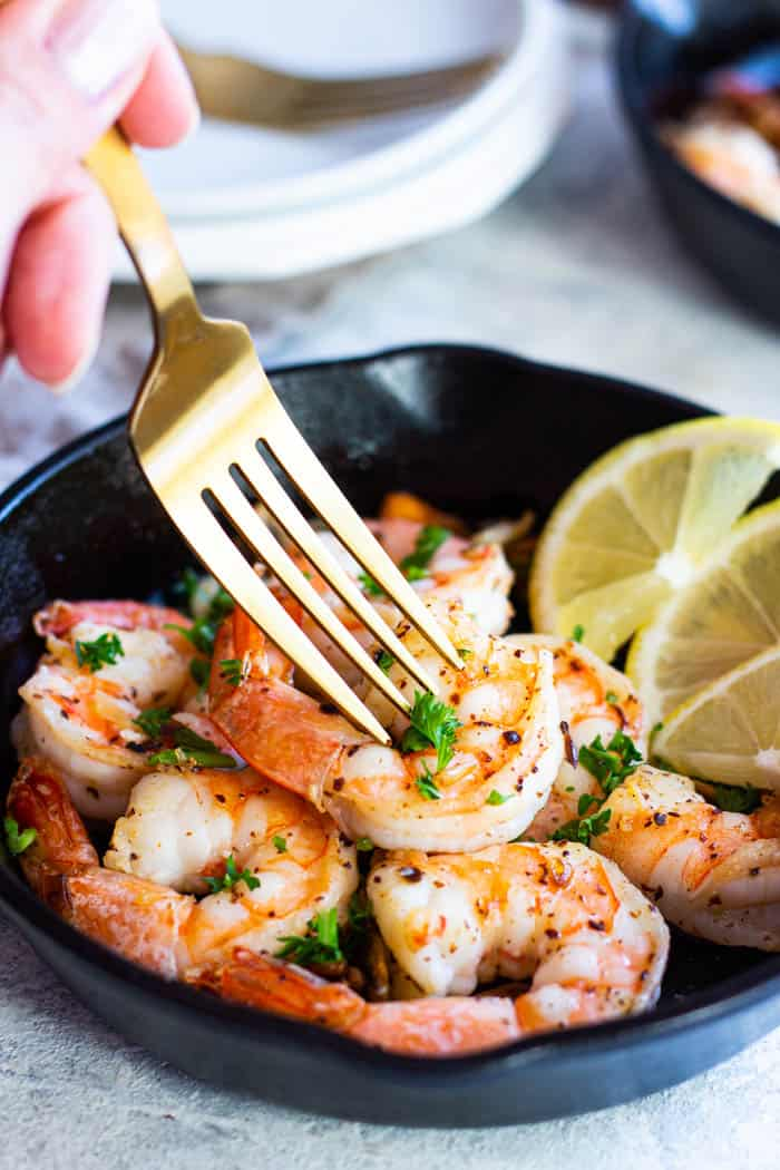 Shrimp is cooked when it's no longer pink. Make sure not to overcook the shrimp.