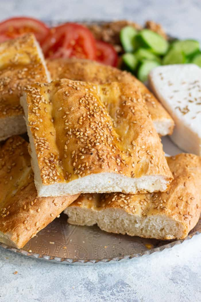 Nan barbari is a classic Persian bread that's easy to make. With a nice crust and soft inside, this bread is a Persian classic that everyone loves.Barbari is easy to make and goes perfectly with some cheese and walnuts! #Persianrecipes #Persianfood #Breadrecipes #Easybreadrecipes