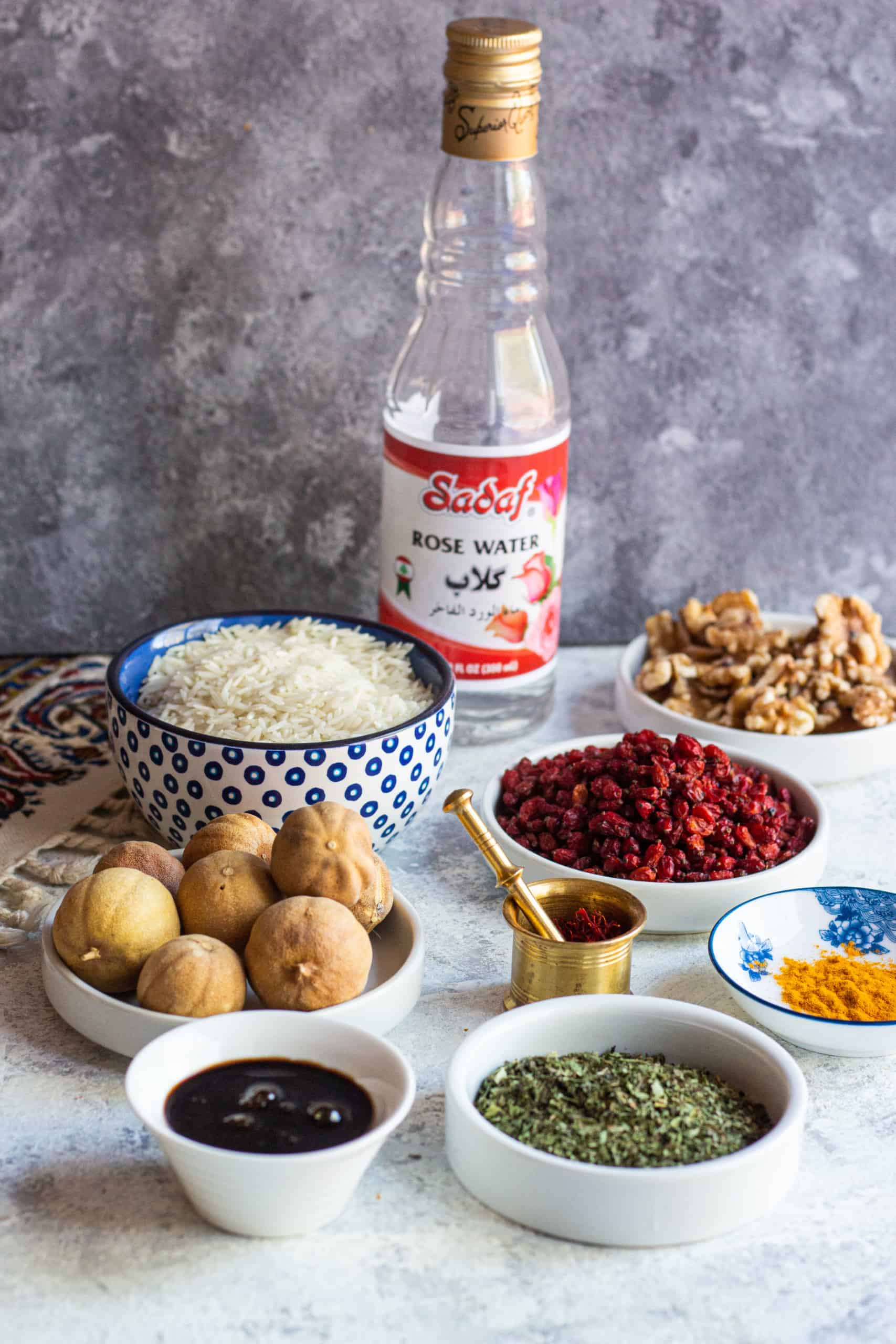 The items you need in your Persian pantry are rosewater, saffron, rice, barberries, pomegranate molasses, walnuts, dried lime, tomato paste and dried herbs.