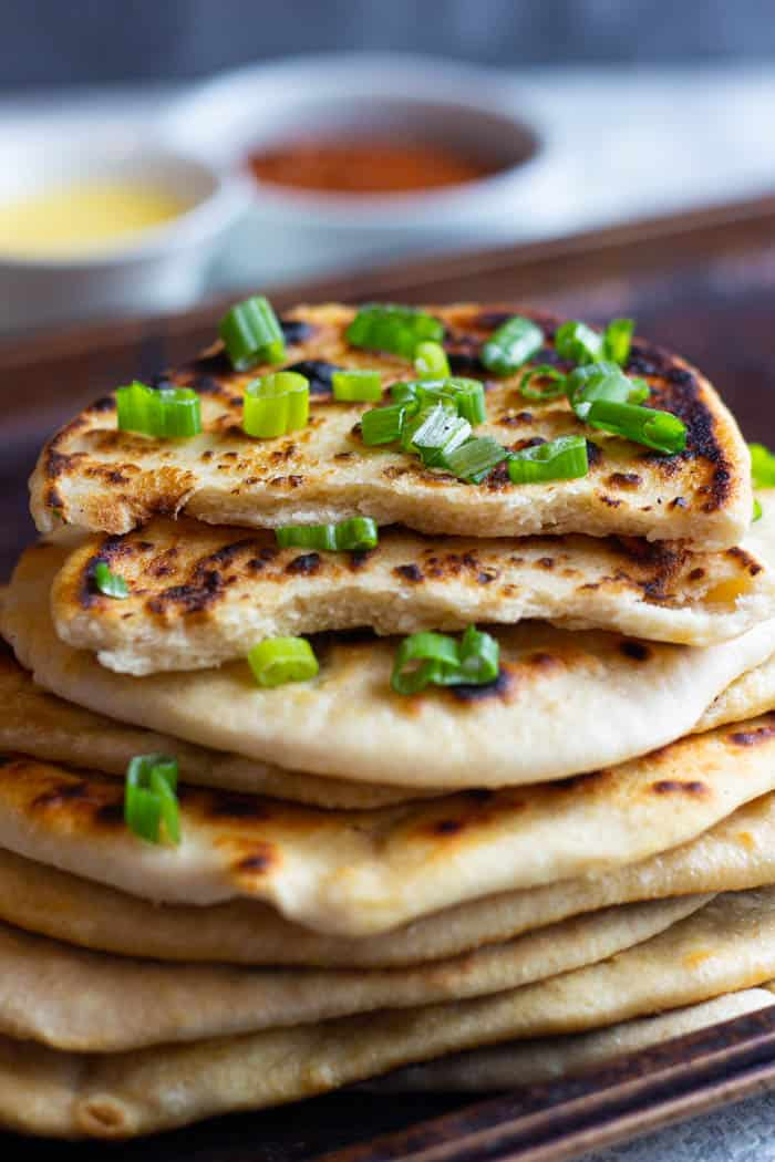 Stack naan on top of each other to keep them warm.