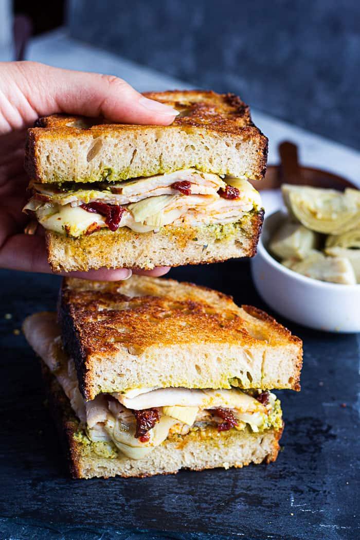 Cut the panini in half and serve immediately.