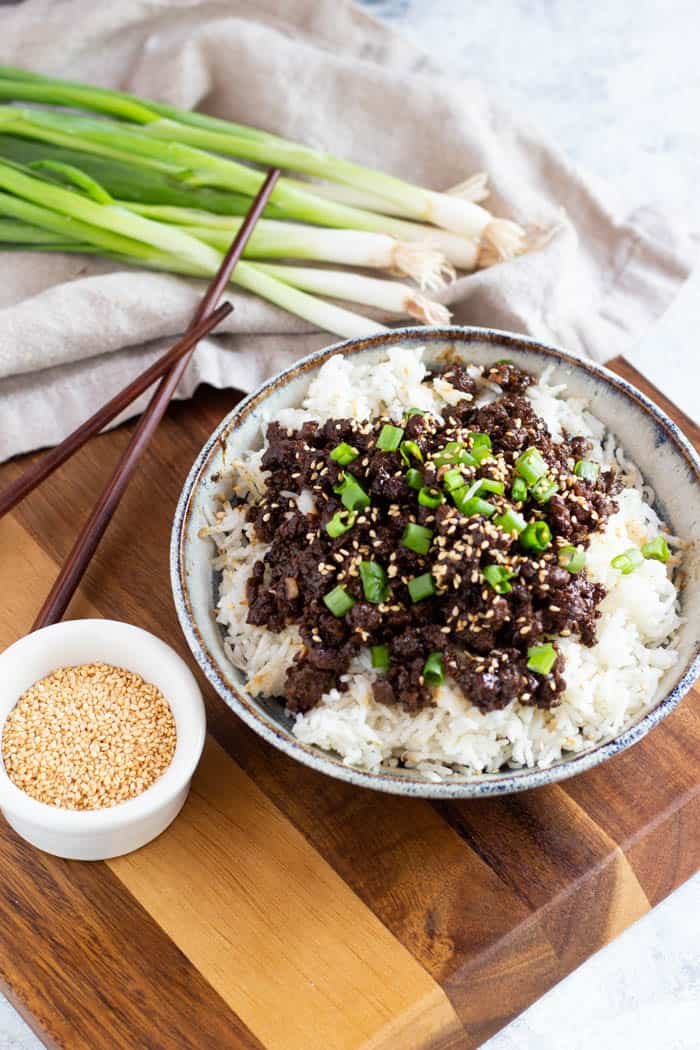 Top the dish with green onions and sesame seeds.