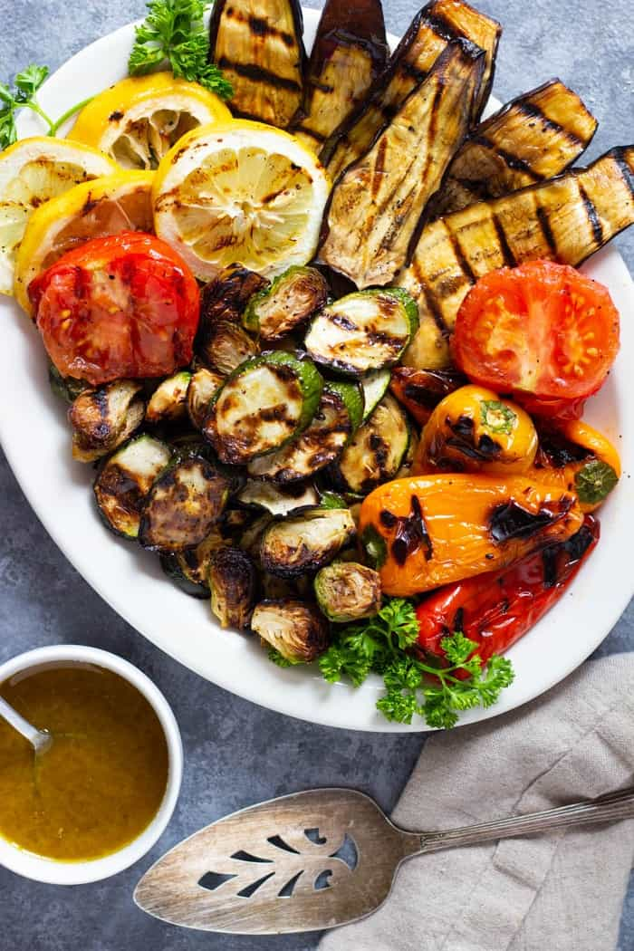 Grilled vegetable platter with a zesty dressing.