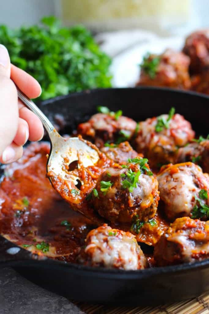 Juicy Italian beef meatballs are topped with shredded mozzarella cheese.