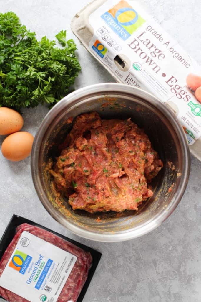 To make Italian beef meatballs, mix all the ingredients in a large bowl.