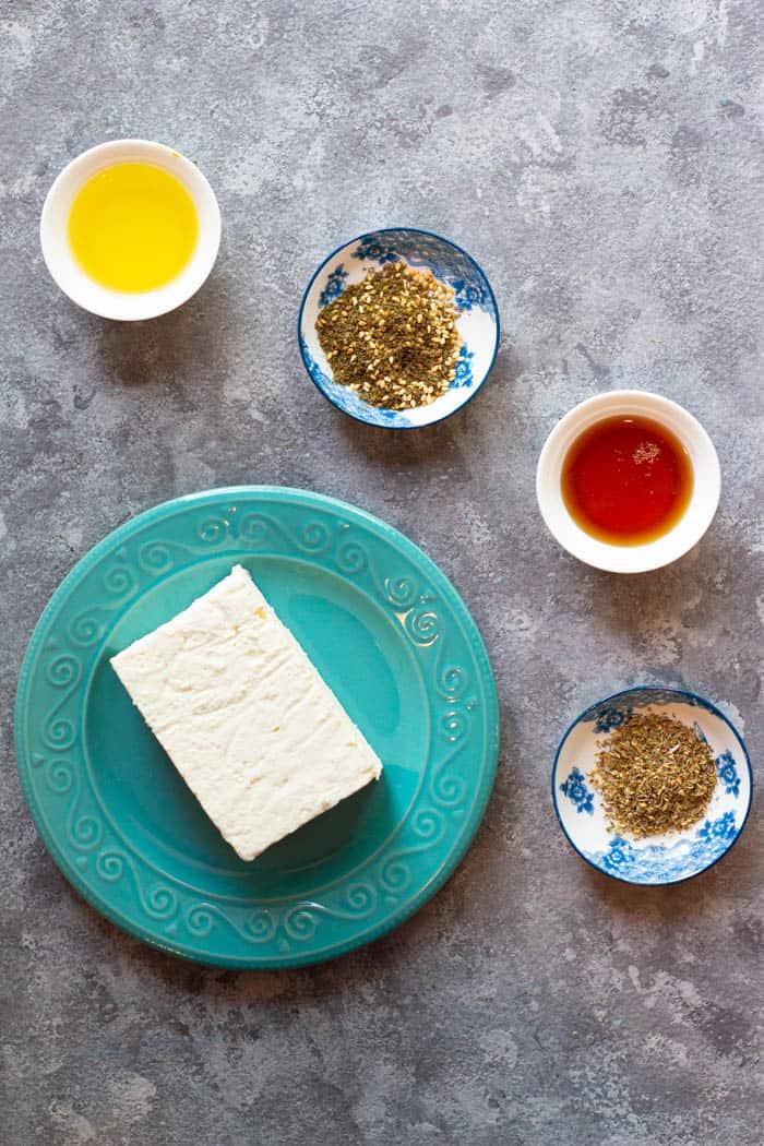 To make this recipe you need feta, oregano, olive oil, honey and zaatar.