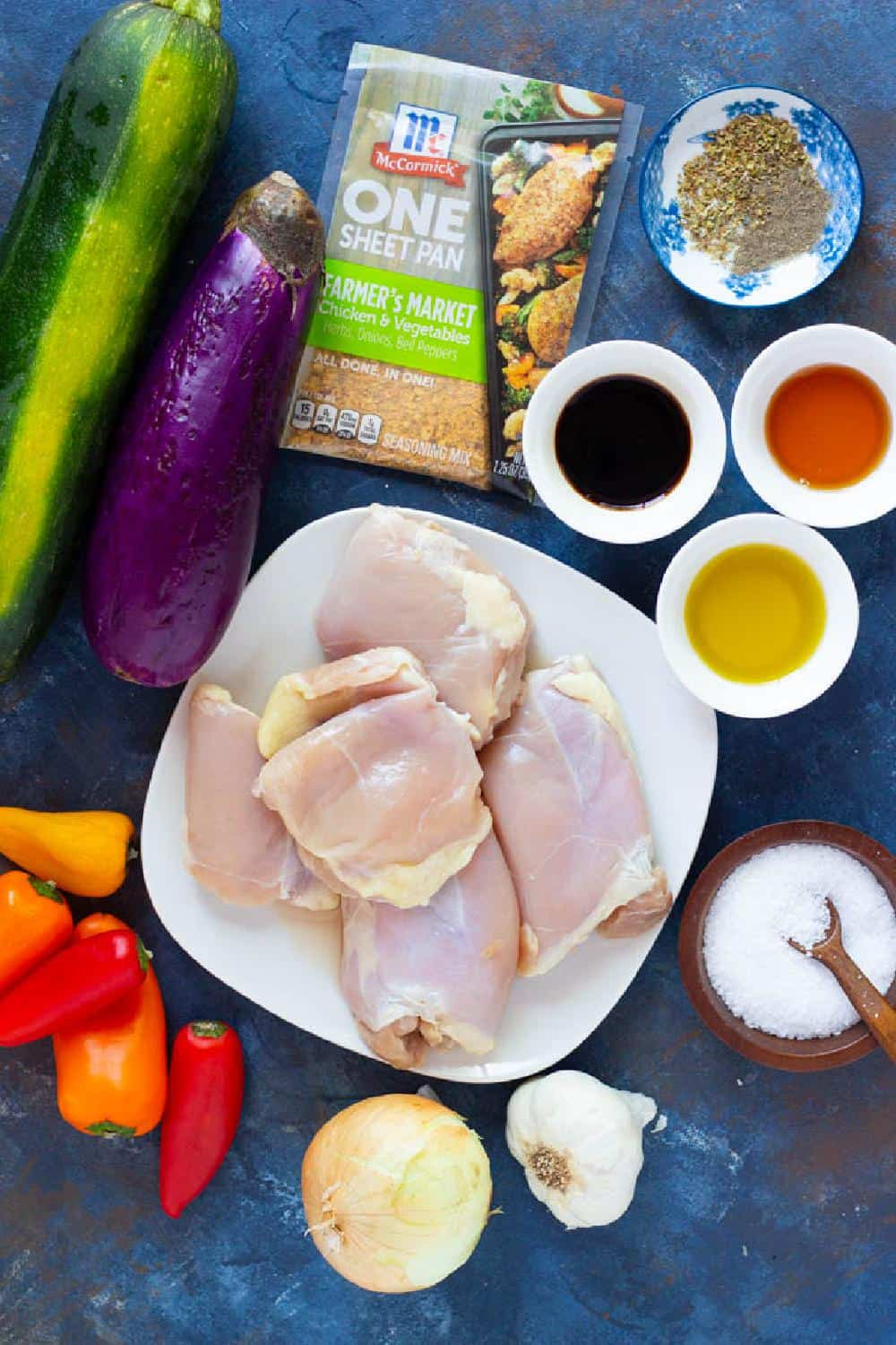 To make sheet pan honey balsamic chicken you need chicken, balsamic vinegar, olive oil, honey, eggplant, zucchini, peppers, spices and salt.