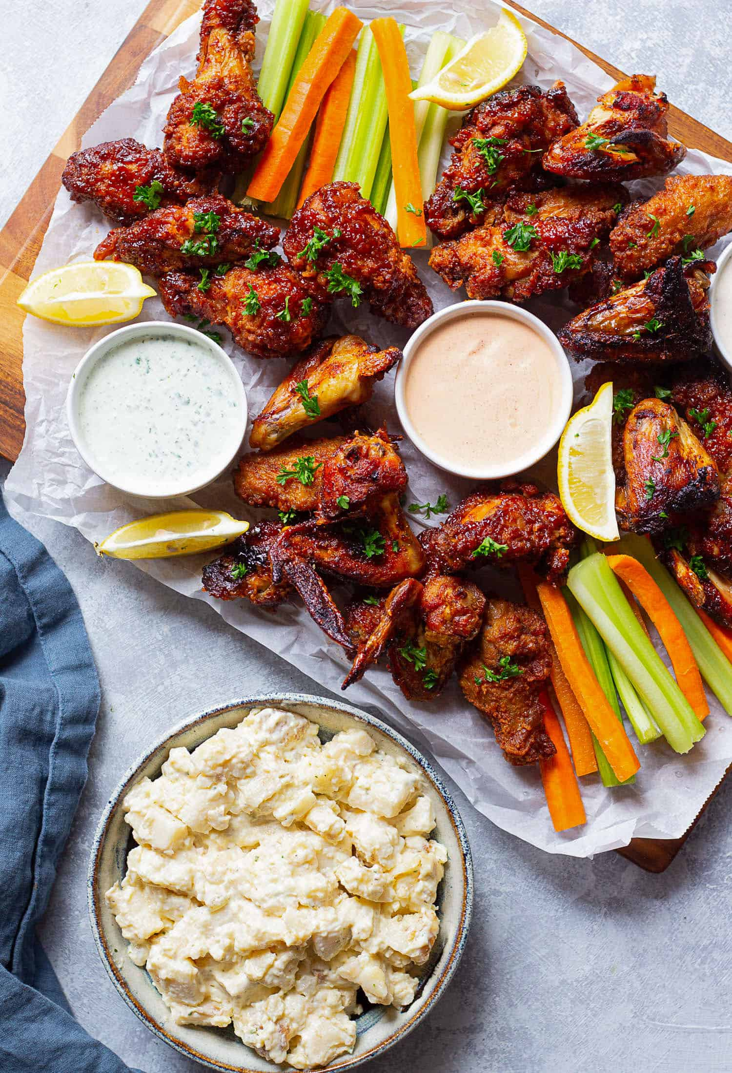 Serve wings with sauces and a side of potato salad.