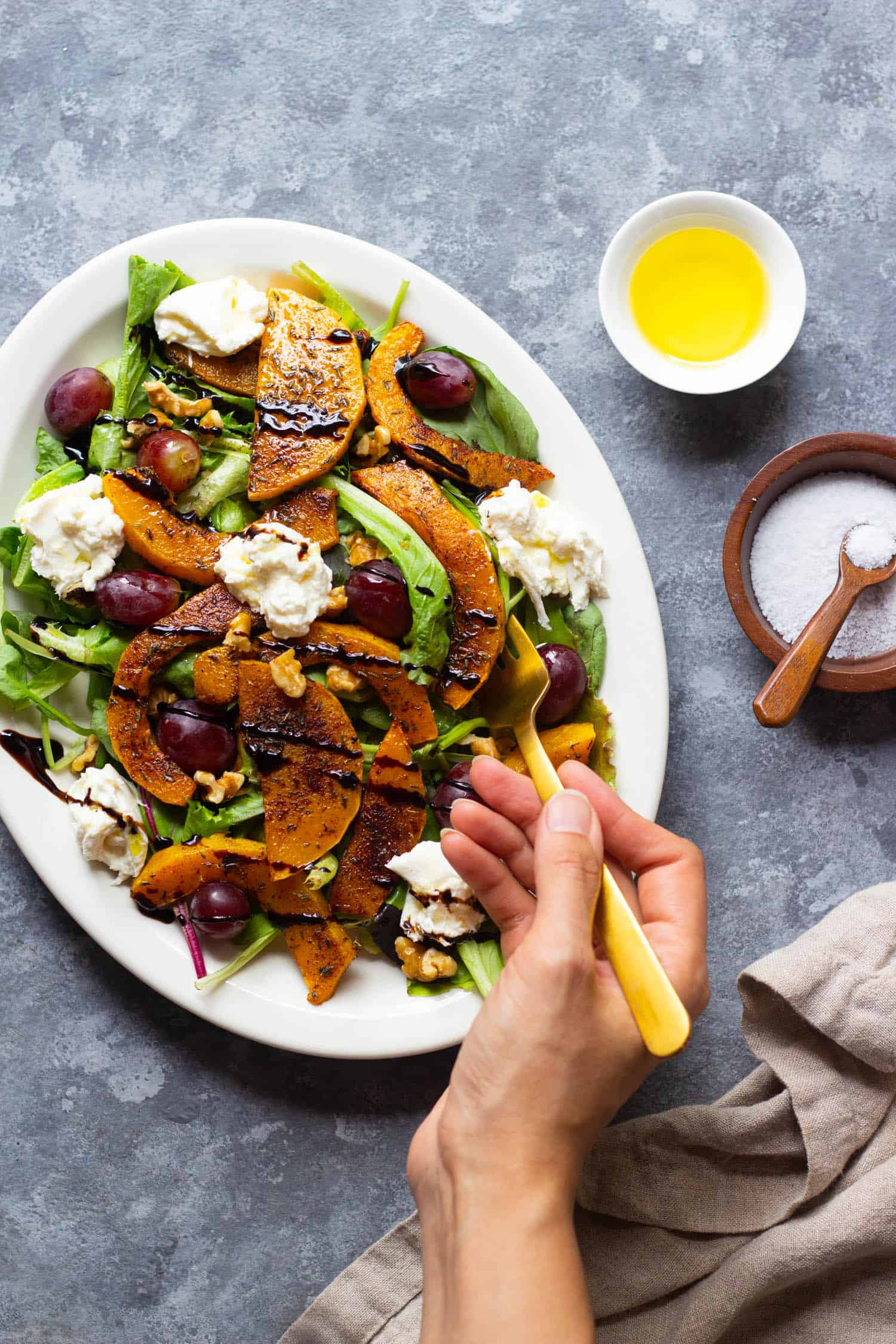 Roasted butternut squash salad topped with burrata and balsamic vinaigrette.