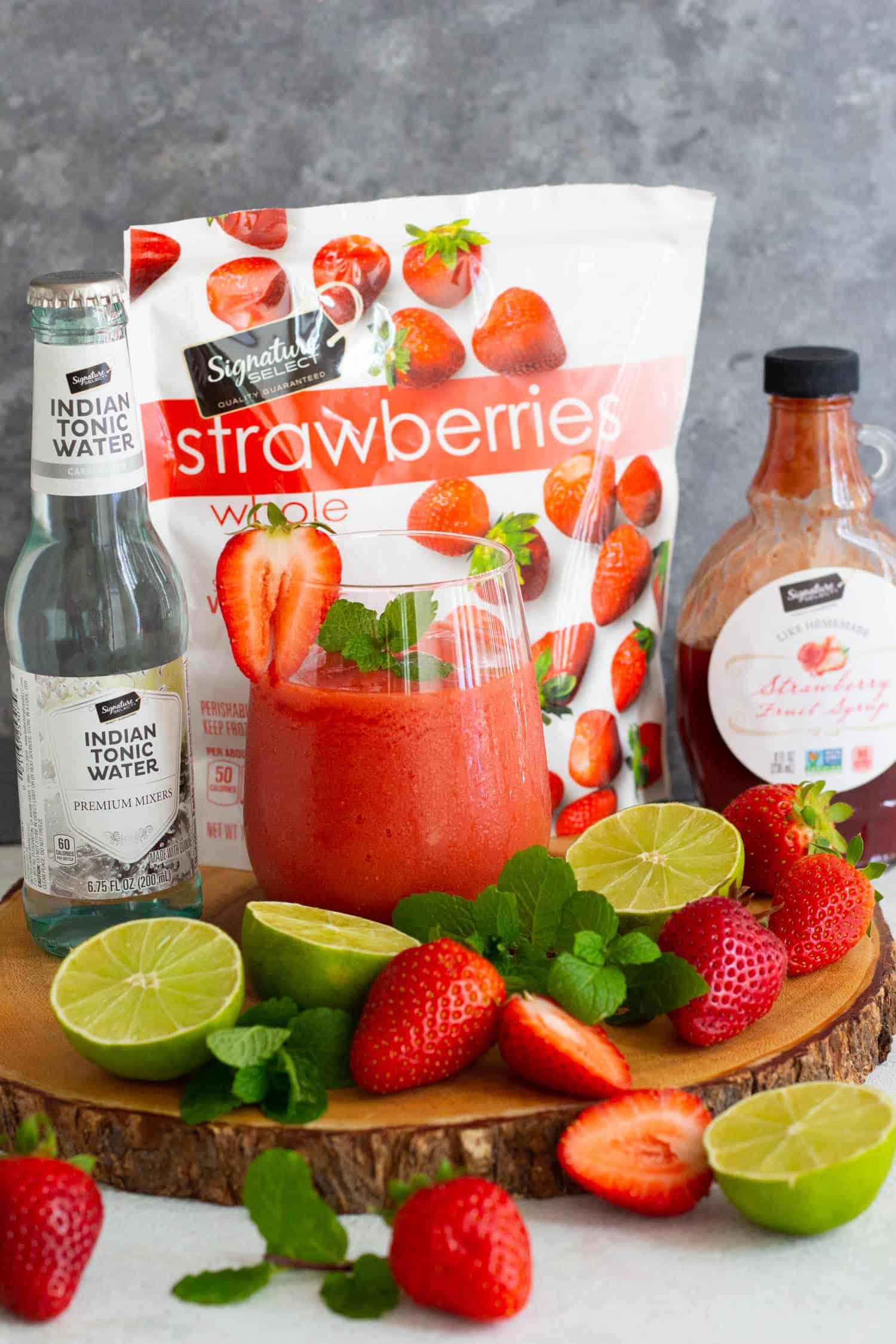 Virgin strawberry daiquiri with ingredients.