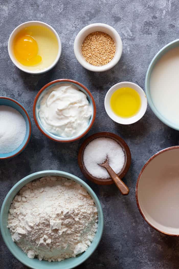 To make this recipe you need water, milk, olive oil, sugar, salt, egg, flour and yogurt.