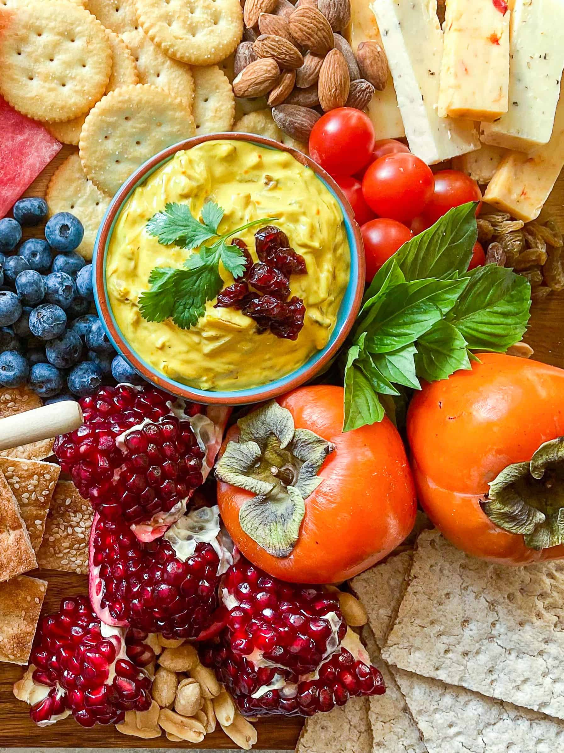 Yalda board also has pomegranates, crackers, cheese and nuts.