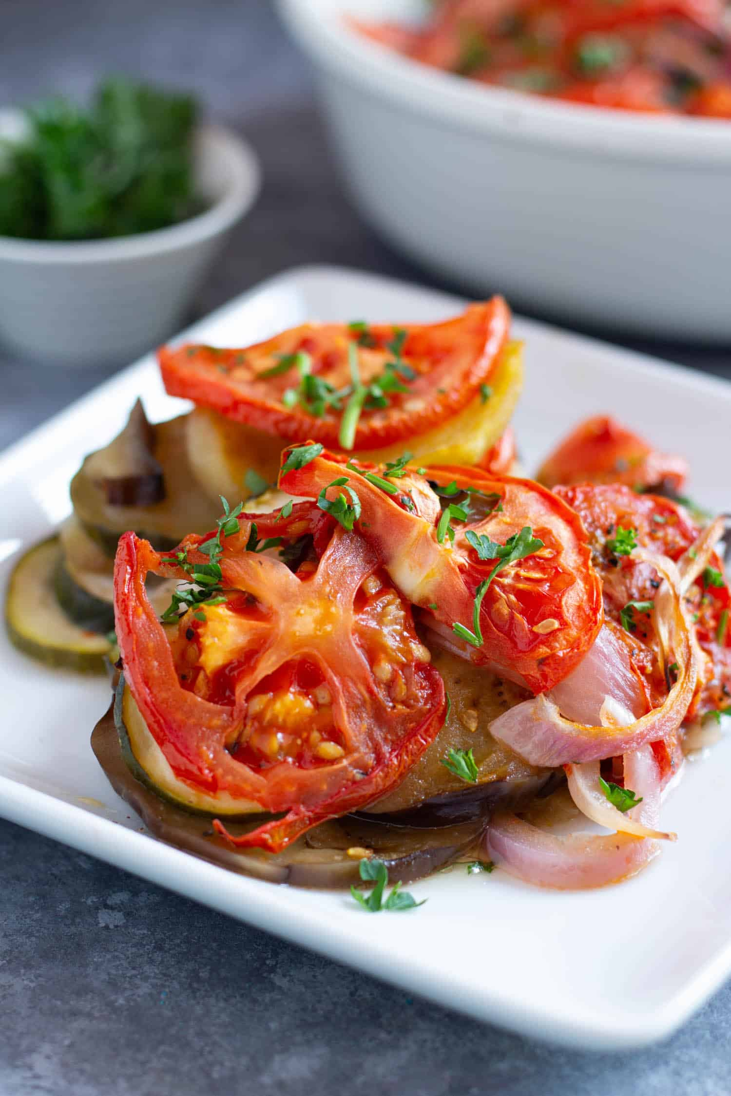 Briam is easy to make and topped with tomatoes and onions. Perfect for a light lunch or dinner.
