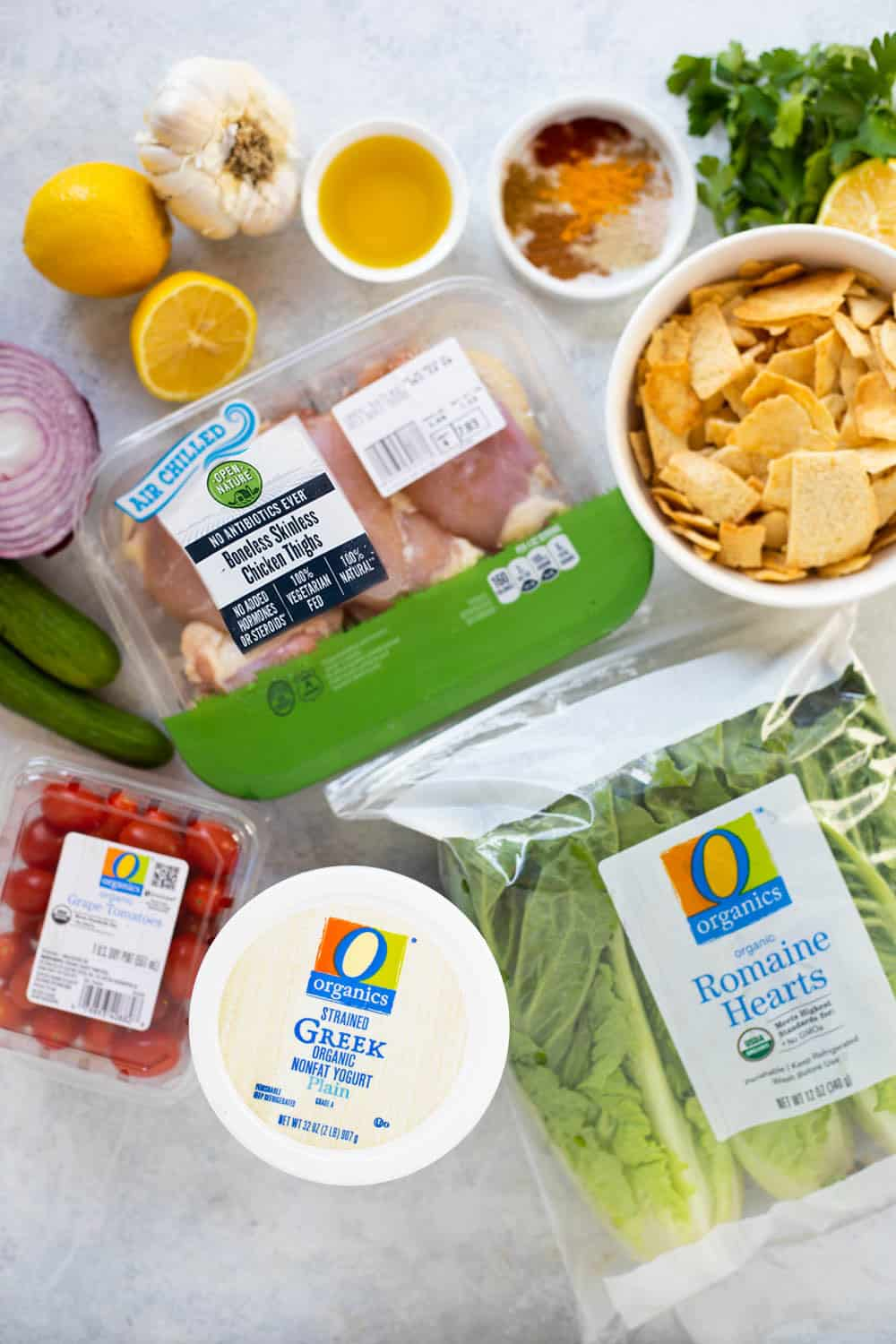 ingredient shot includes chicken, pita chips, vegetables and lettuce.