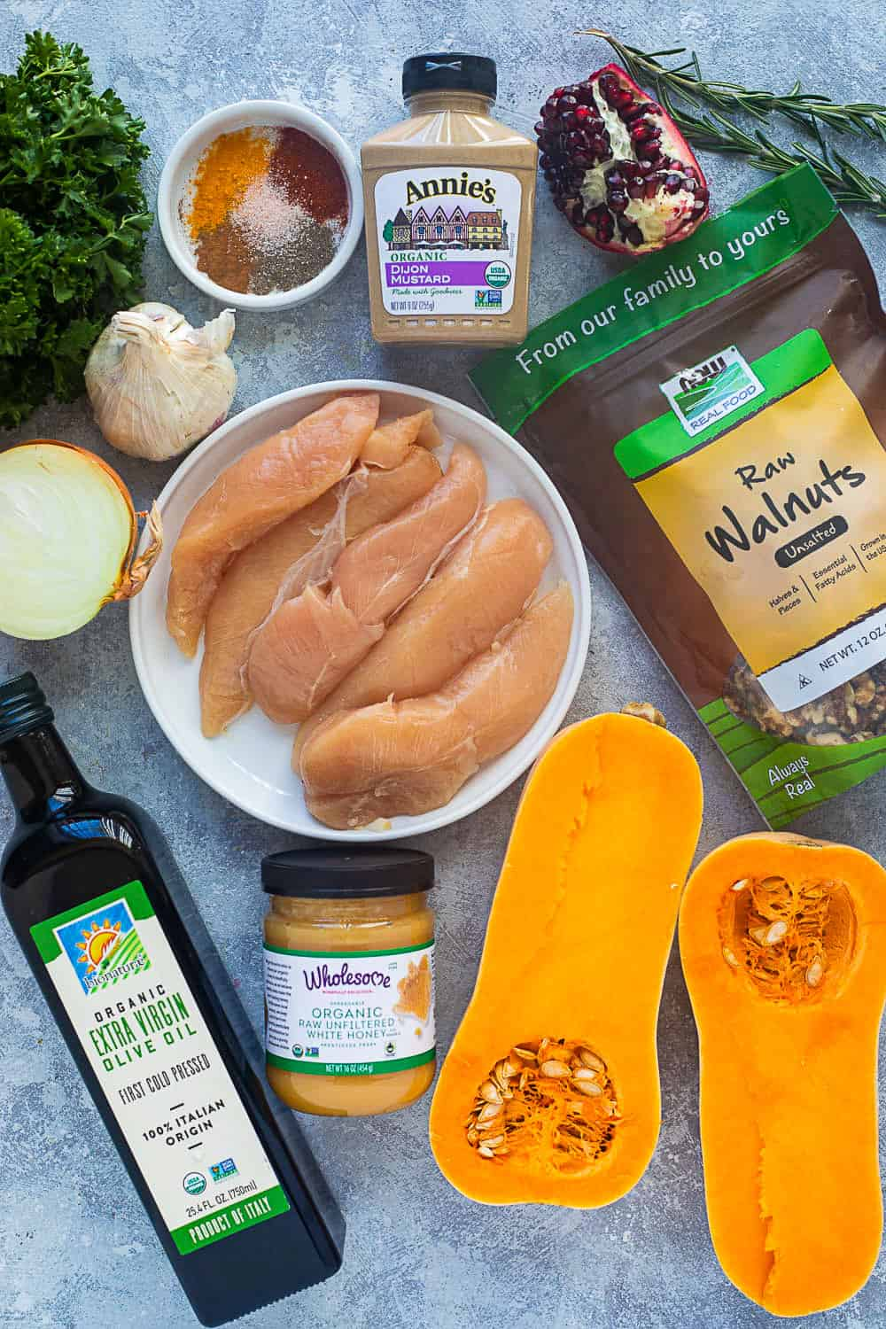 To make skillet chicken and butternut squash you need chicken tenders, spices, garlic, onion, butternut squash, olive oil, walnut, honey and pomegranate.