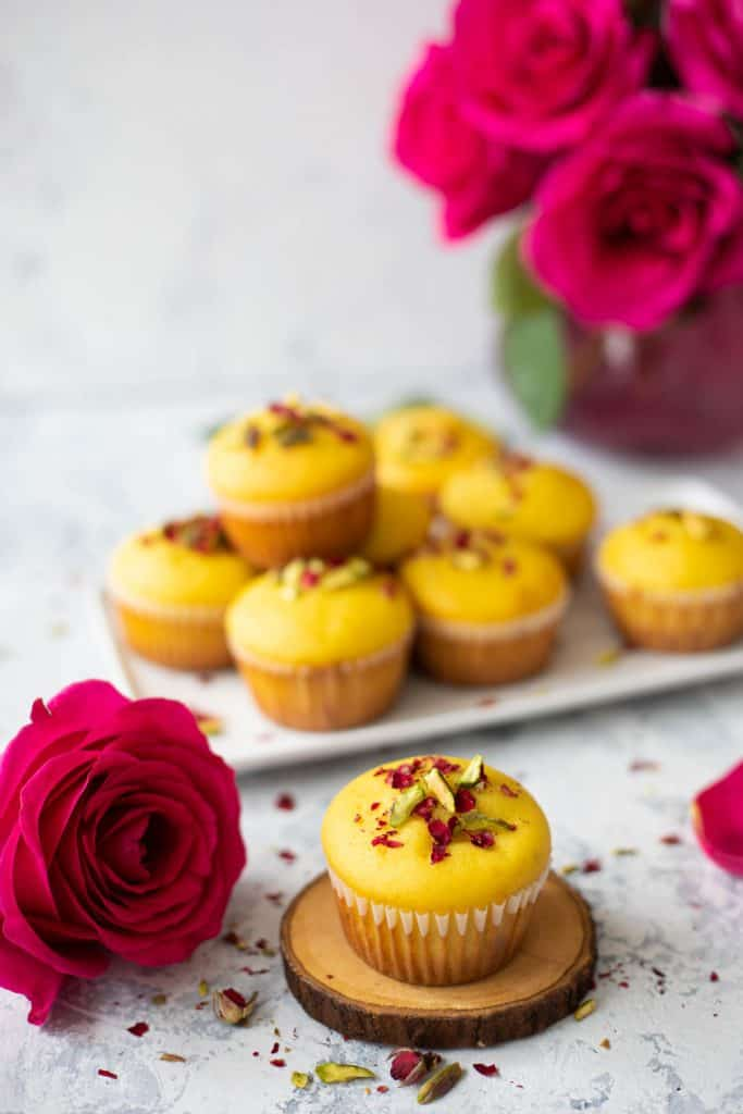 Closeup shot of saffron and rose muffins.