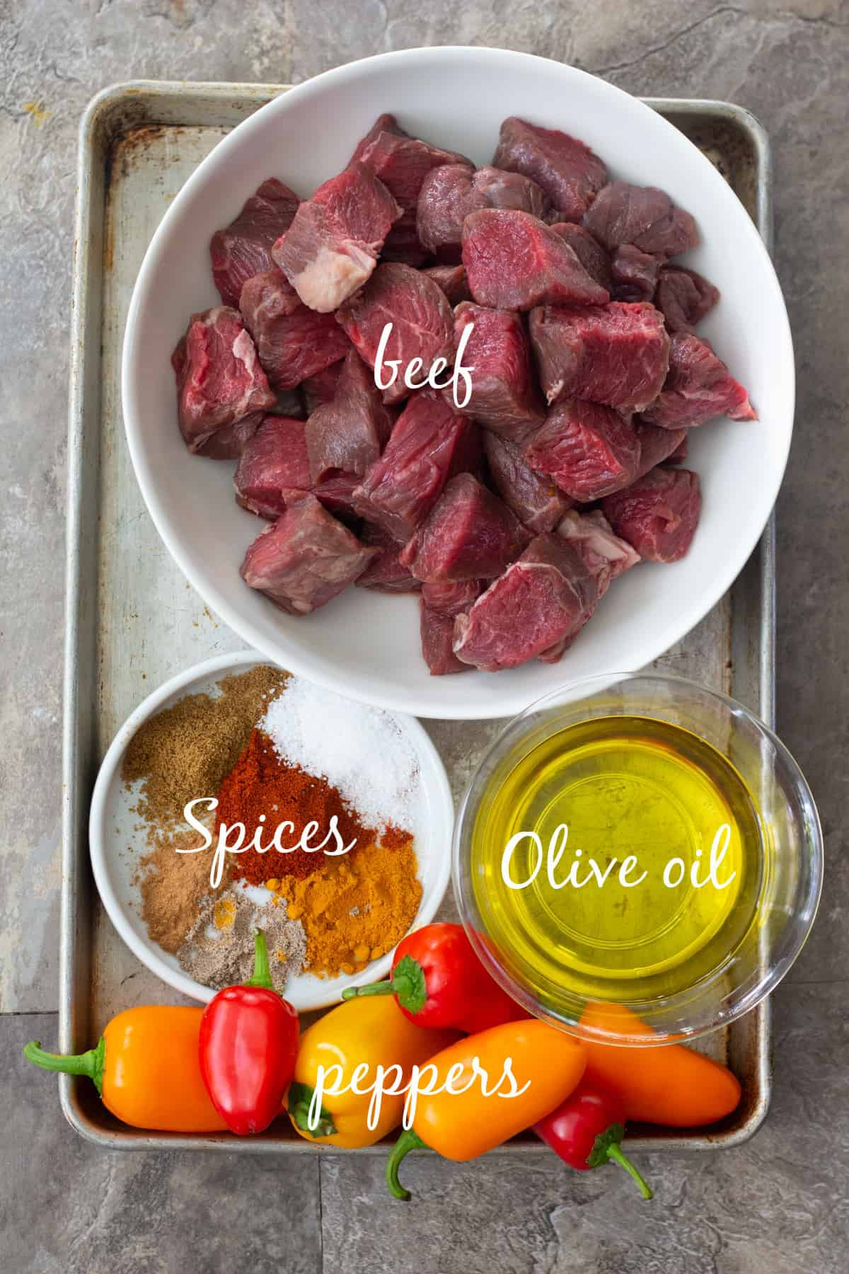 For this recipe you need beef chunks, olive oil, spices and peppers.