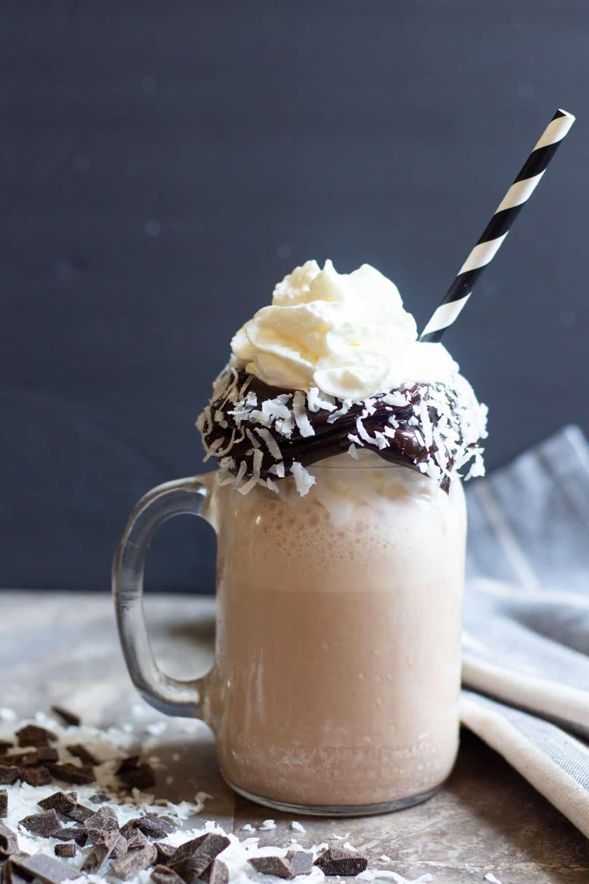 coconut chocolate milkshake with a straw