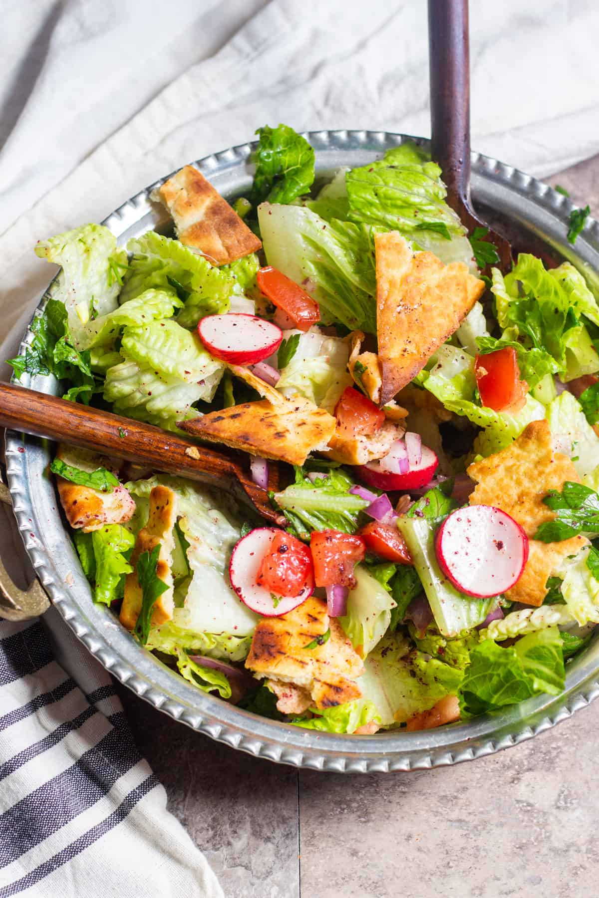 Fattoush is a simple Middle Eastern chopped salad that's perfect for any meal. This Fattoush recipe is easy to follow and uses seasonal fresh ingredients.