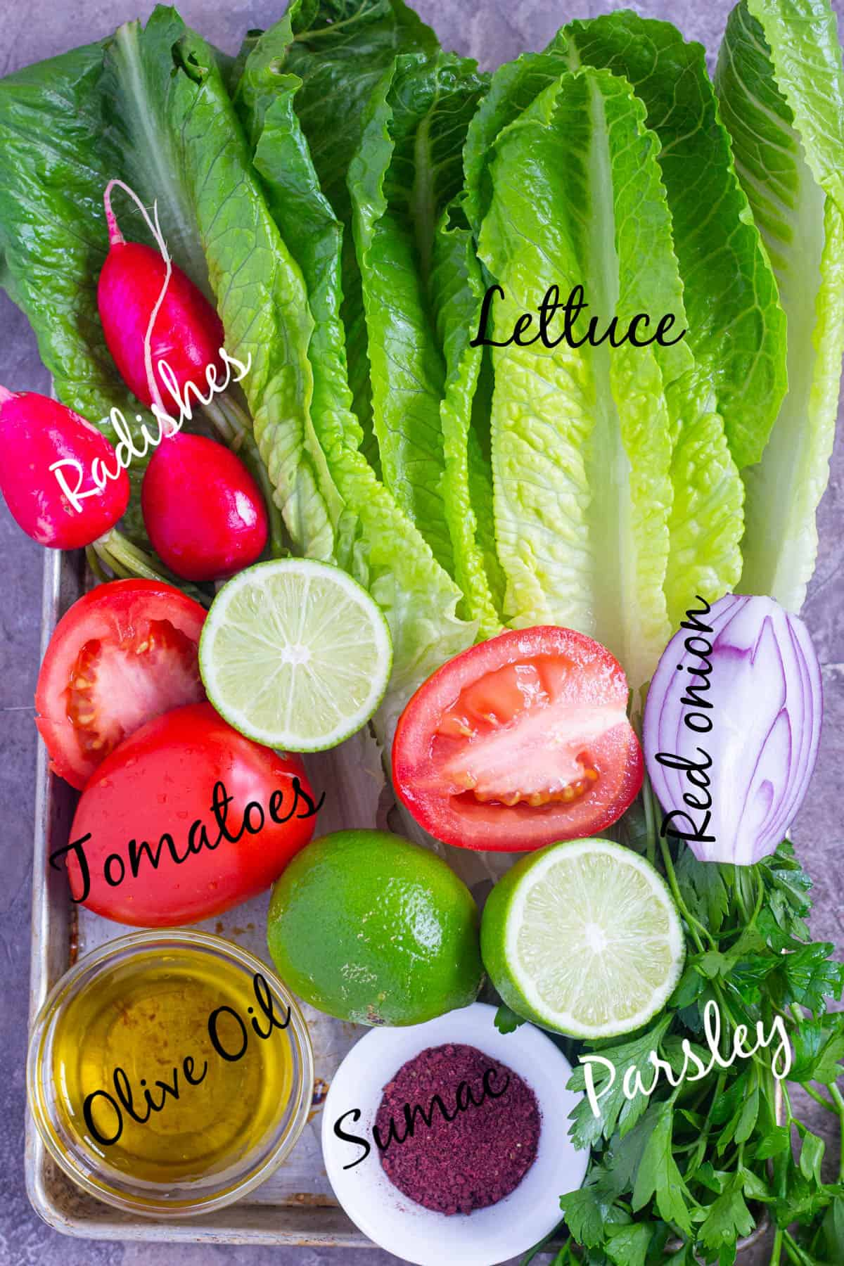 Lebanese salad ingredients are lettuce, radishes, tomatoes, lime, onion, sumac and parsley.