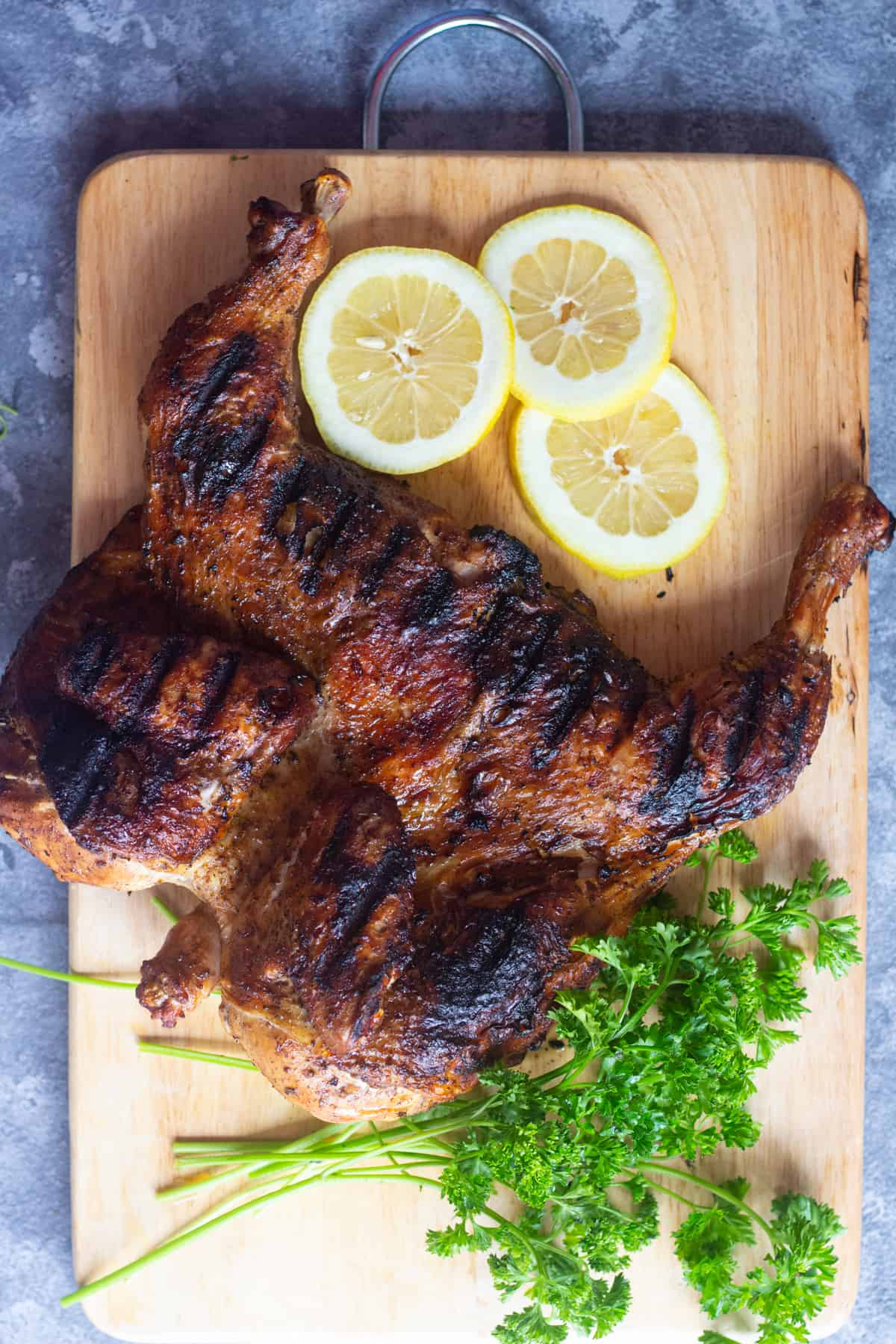 When spatchcocked, the chicken cooks more evenly. Grilled spatchcock chicken is juicy on the inside.