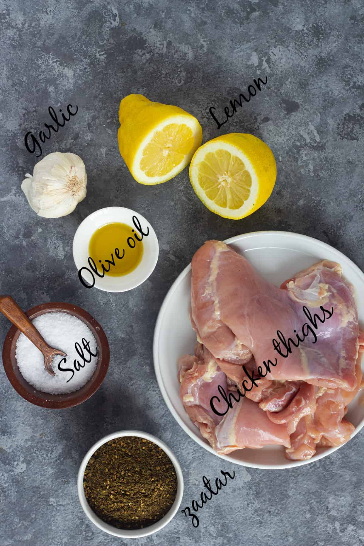 To make this recipe you need chicken thighs, olive oil, salt, zaatar, garlic and lemon juice.