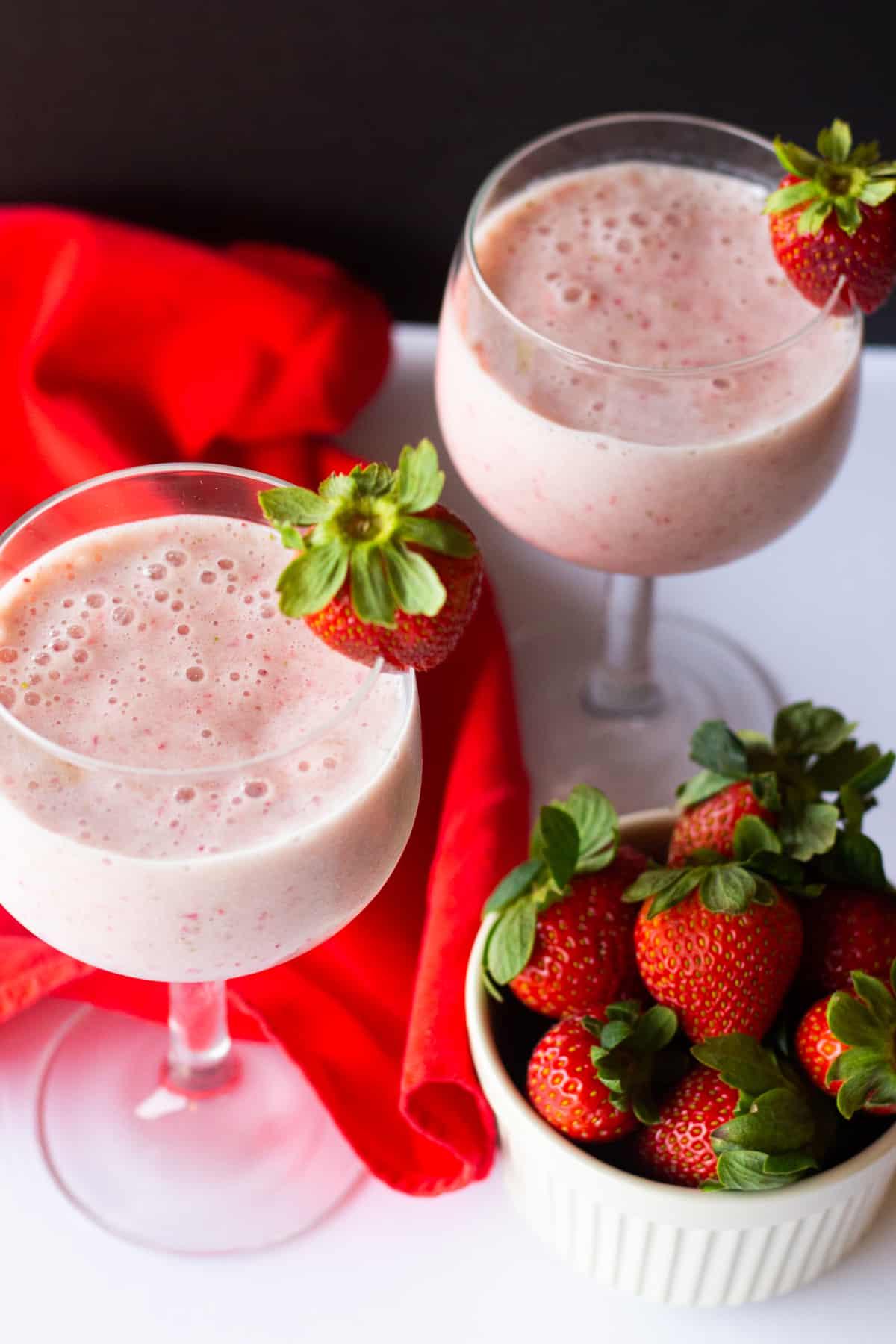 healthy strawberry milkshake recipe is made with fresh strawberries and bananas.