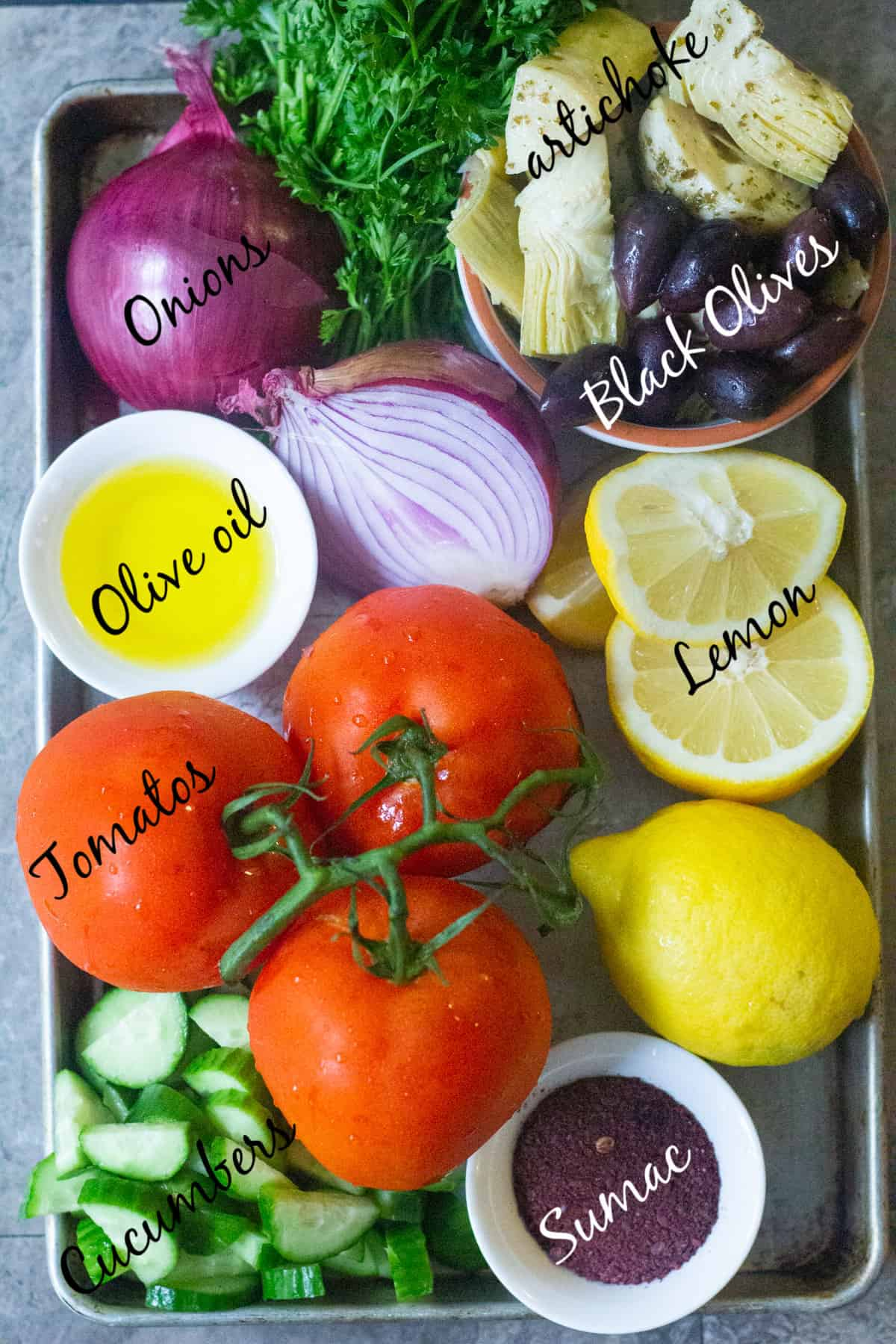 To make Mediterranean cucumber salad you need tomatoes, cucumber, red onion, artichokes, olives, olive oil, sumac and lemon.