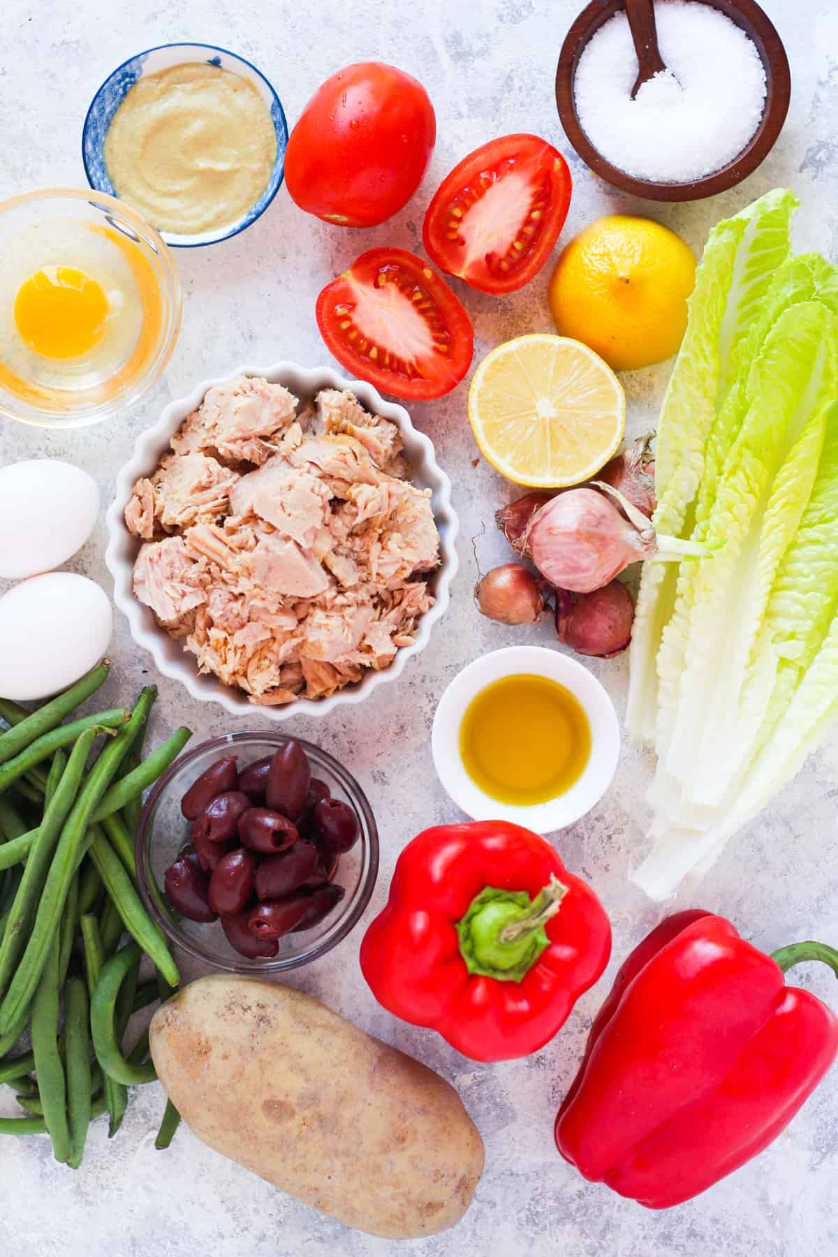 2 yukon gold potatoes peeled and cut into 1 ½ inch pieces 8 oz green beans 4 large hard boiled eggs ▢1 head lettuce washed and chopped 2 cans tuna in olive oil drained ½ red bell pepper sliced 1 cup nicoise olives or kalamata olives 2 roma tomatoes cut into large pieces 1 shallot sliced