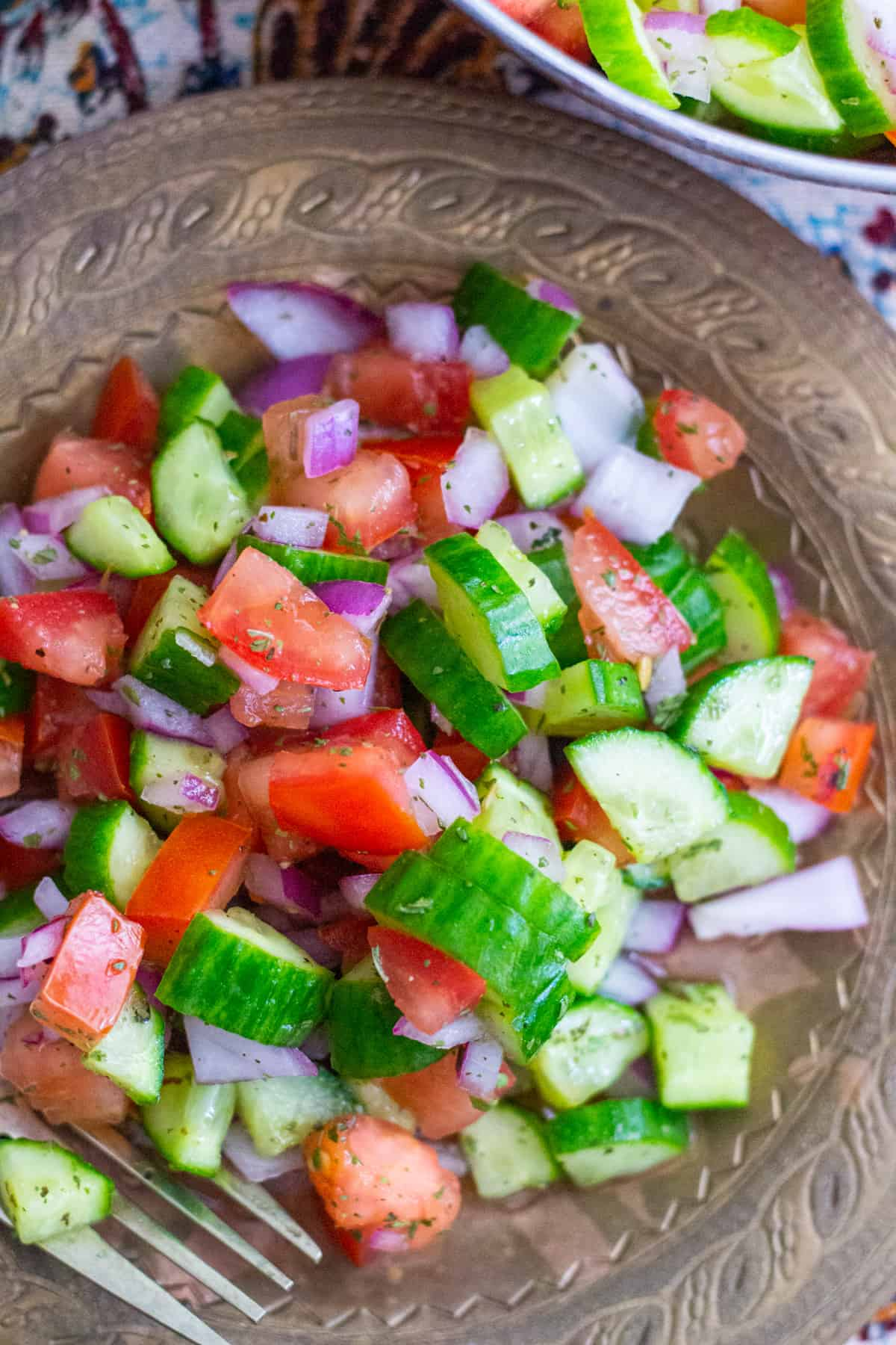 Plump tomatoes and fresh cucumbers go well with red onion. This gluten free, vegetarian salad is perfect with any rice dish.