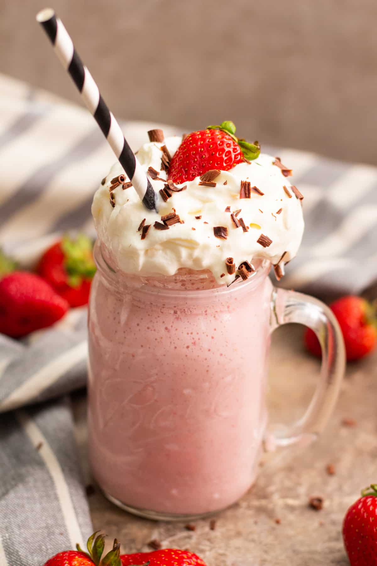 strawberry milkshake topped with whipped cream.