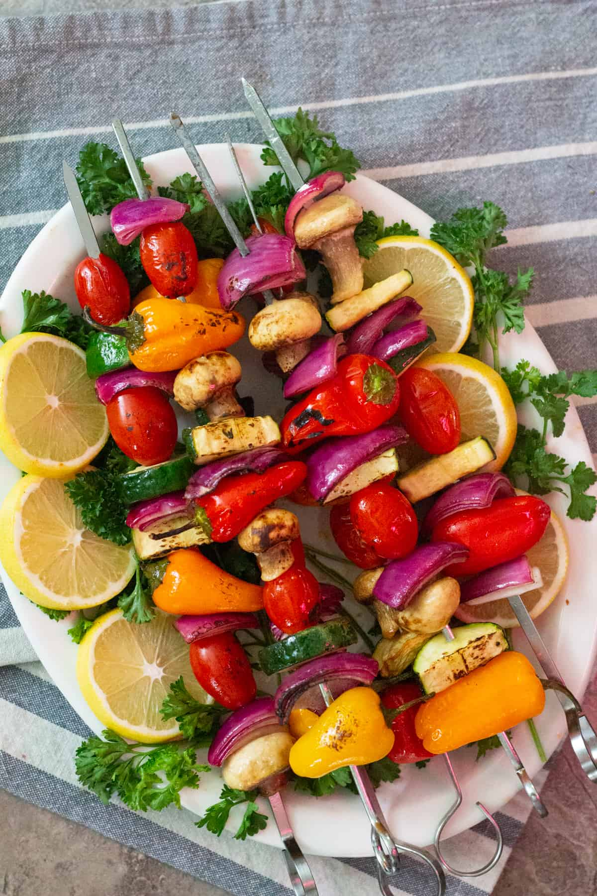 Veggie shish kabob is a great side dish to so many dishes such as chicken shawarma, Greek meatballs or homemade falafels. What I love the most about Mediterranean recipes is that they mix and match so well and complement each other beautifully.
