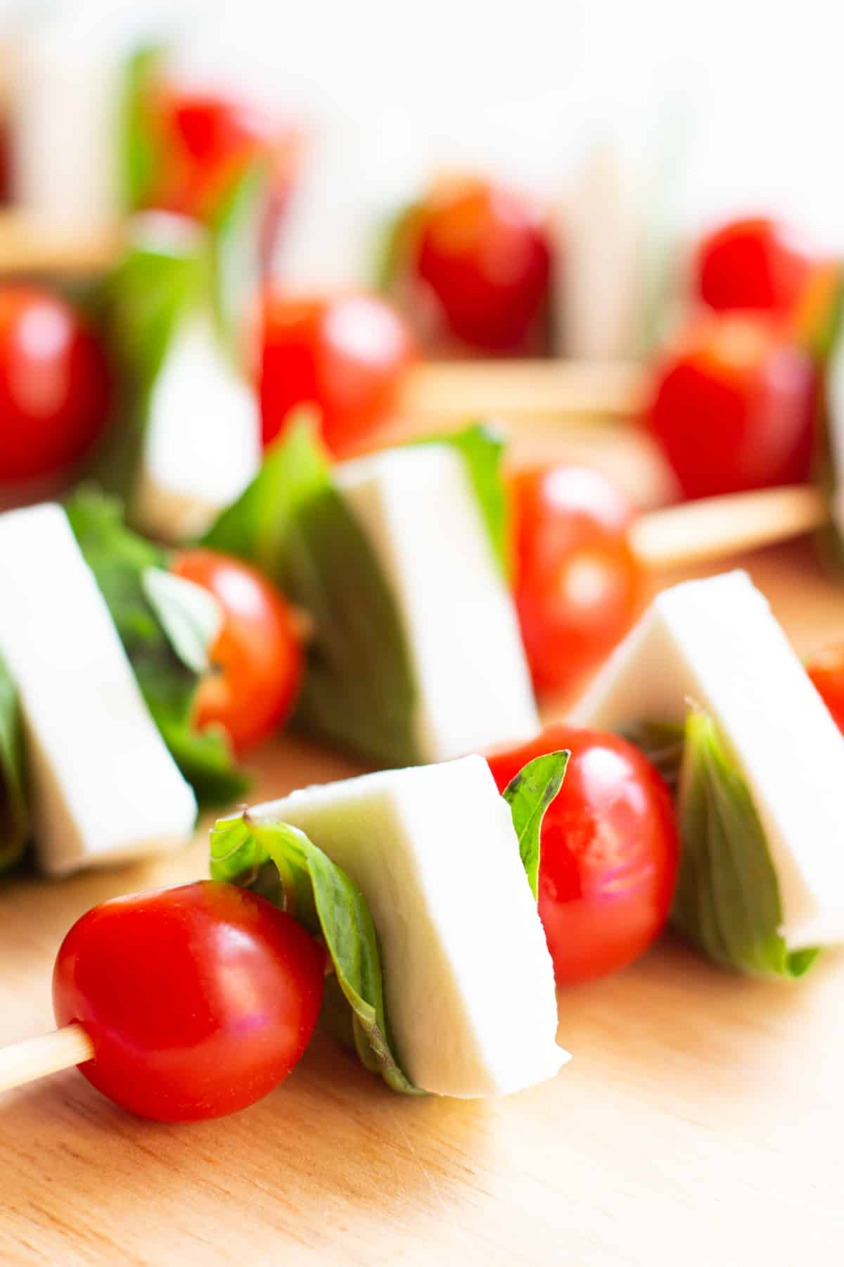 easy mini caprese salad skewers are the perfect appetizer for parties and gatherings.