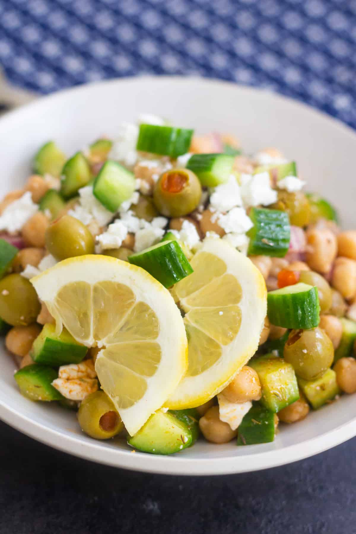 chickpea salad recipe is easy and topped with olives and feta cheese.