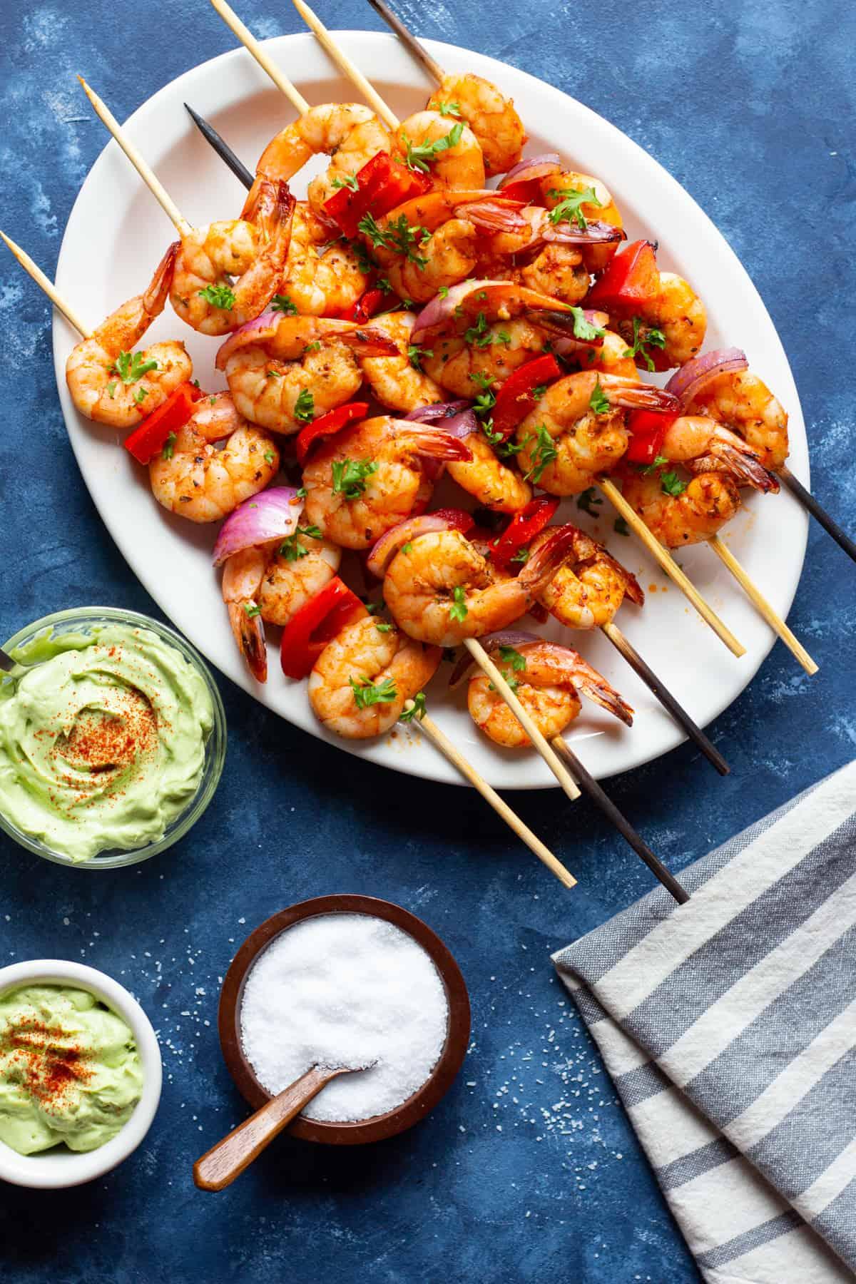 Grilled shrimp kabobs on a platter.