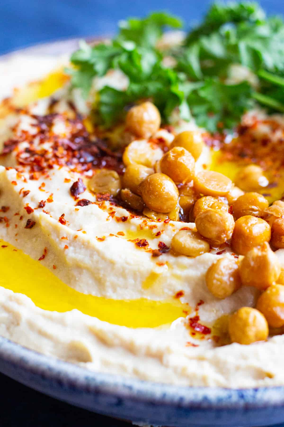 Drizzle with extra virgin olive oil and top with pepper, sumac and crispy chickpeas