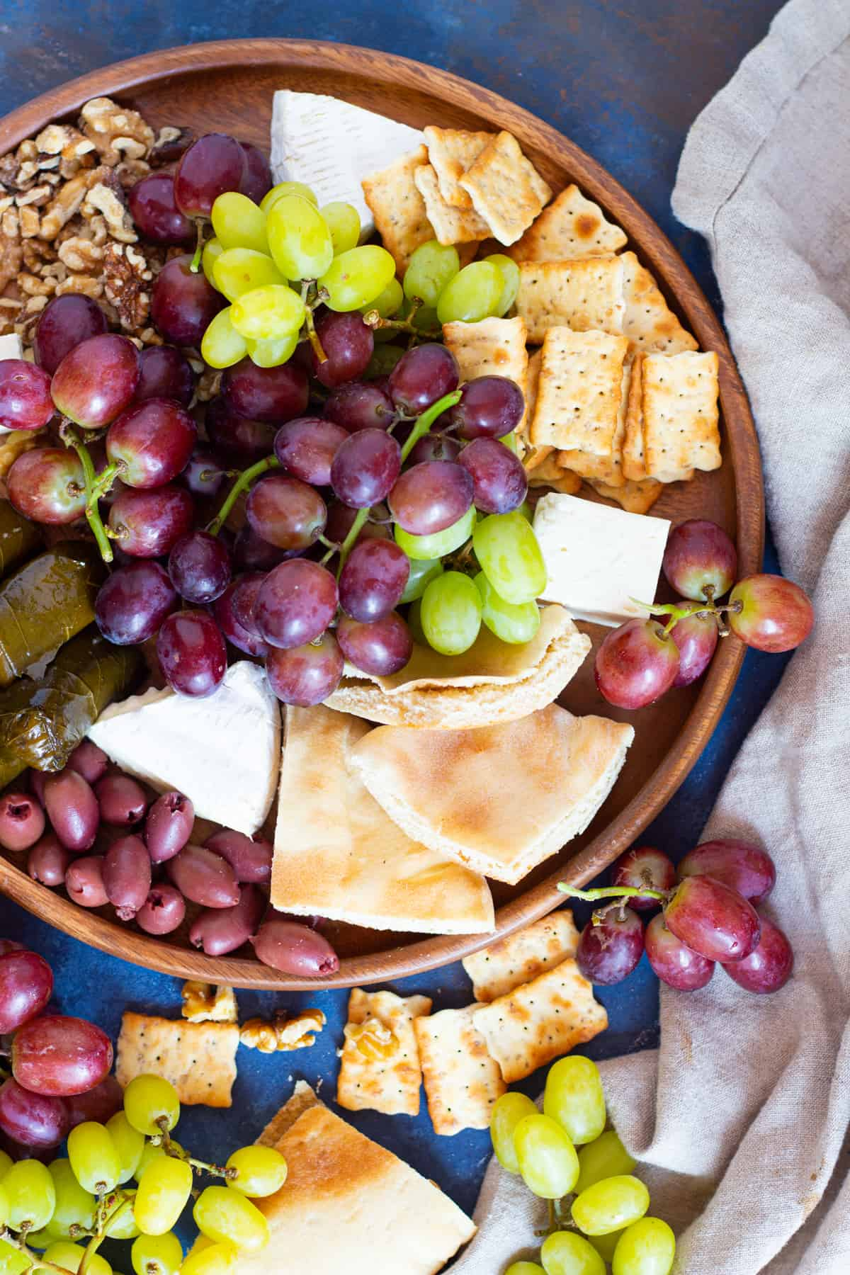 Add pita and crackers to the appetizer board.