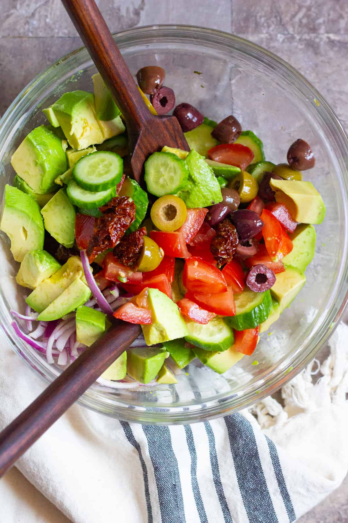 Mix all the ingredients for cucumber avocado salad in a large bowl.