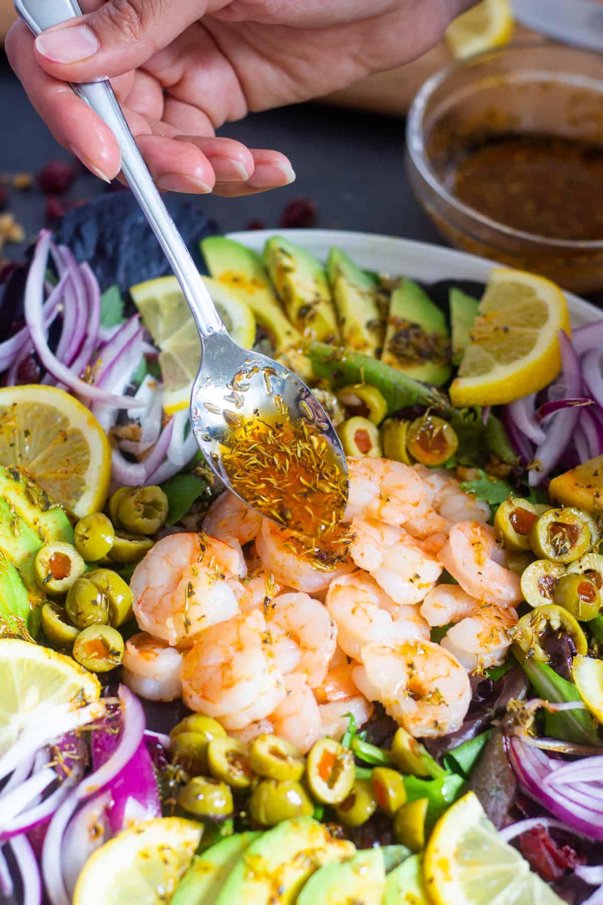 Add dressing to shrimp and avocado salad.