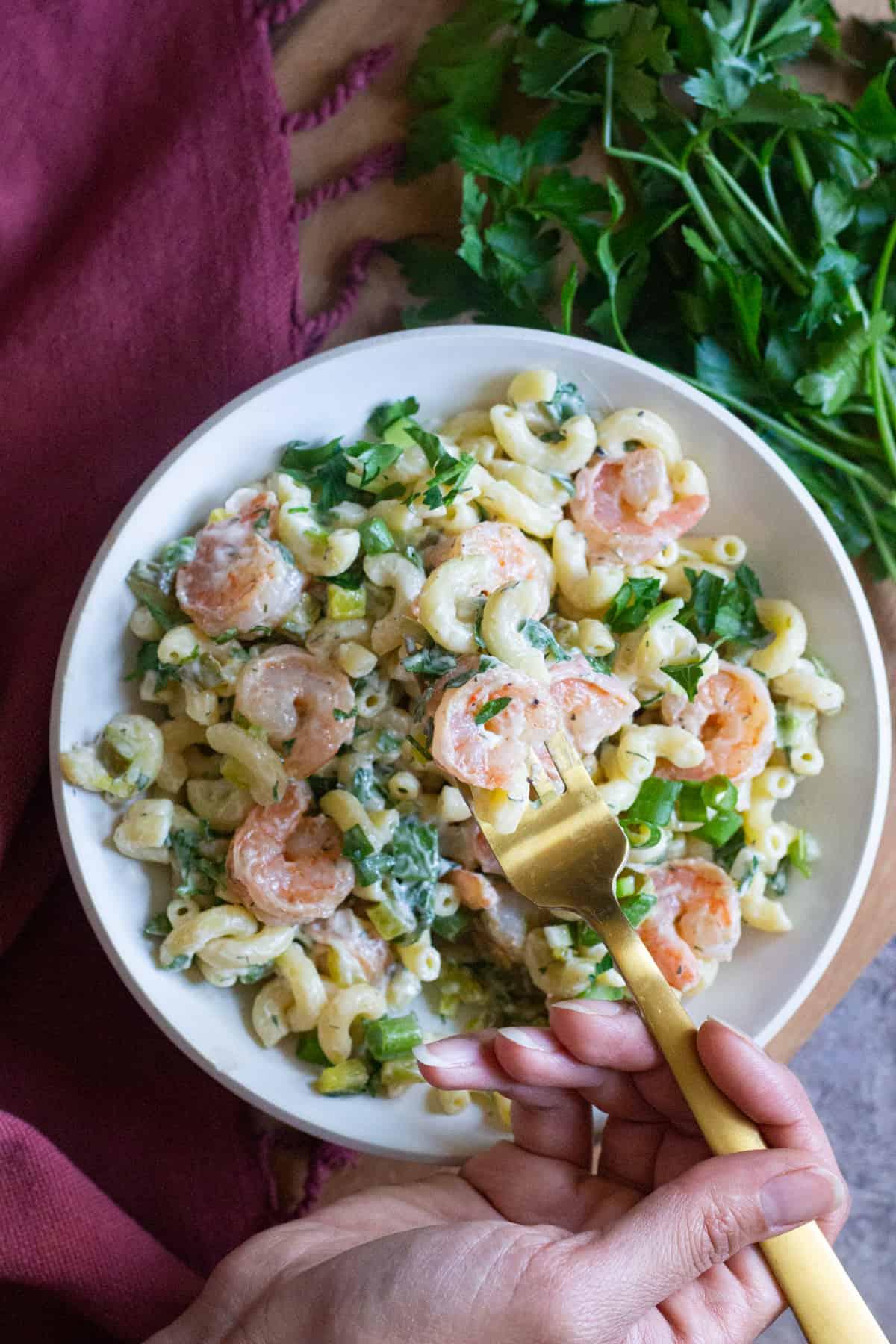 Serve cold shrimp pasta salad after chilling in the fridge for one hour.