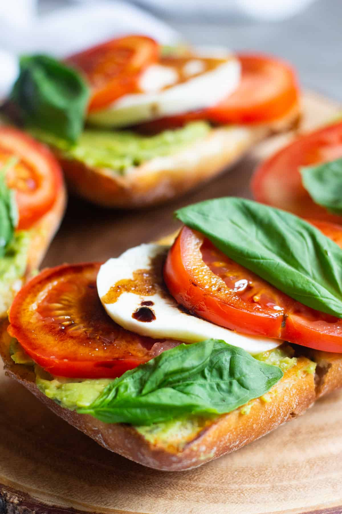 Italian bread with avocados, tomatoes and mozzarella. Topped with balsamic reduction and basil.