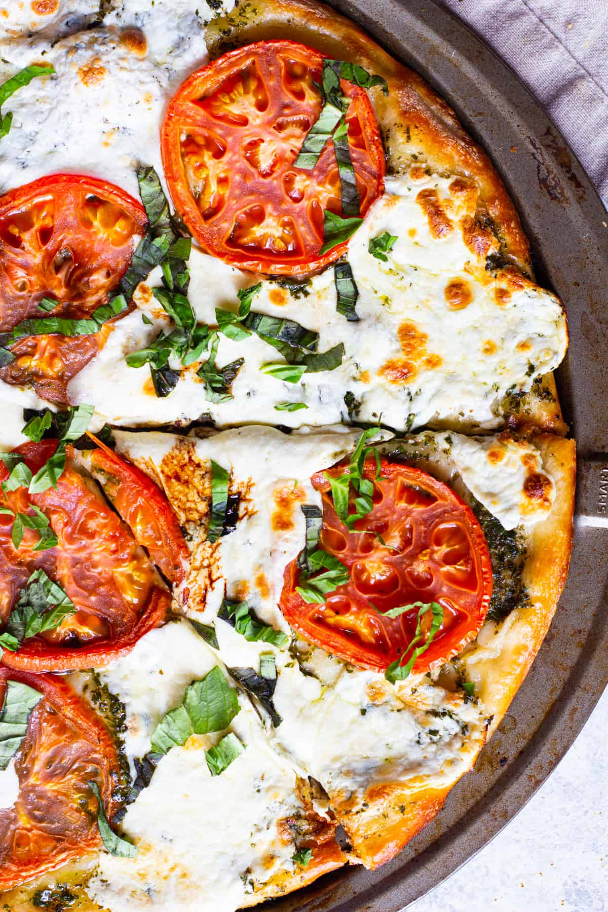 Pizza with mozzarella, tomatoes and basil.