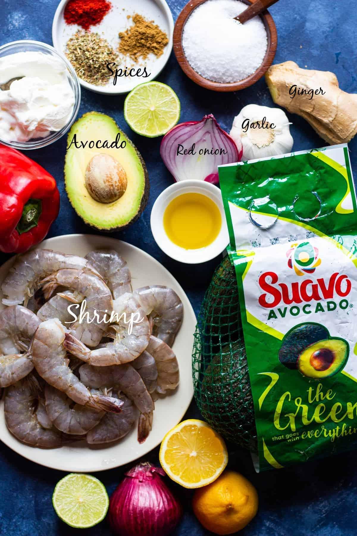 Ingredients are shrimp, spices, olive oil, avocado, yogurt, lemon, lime, ginger and garlic.