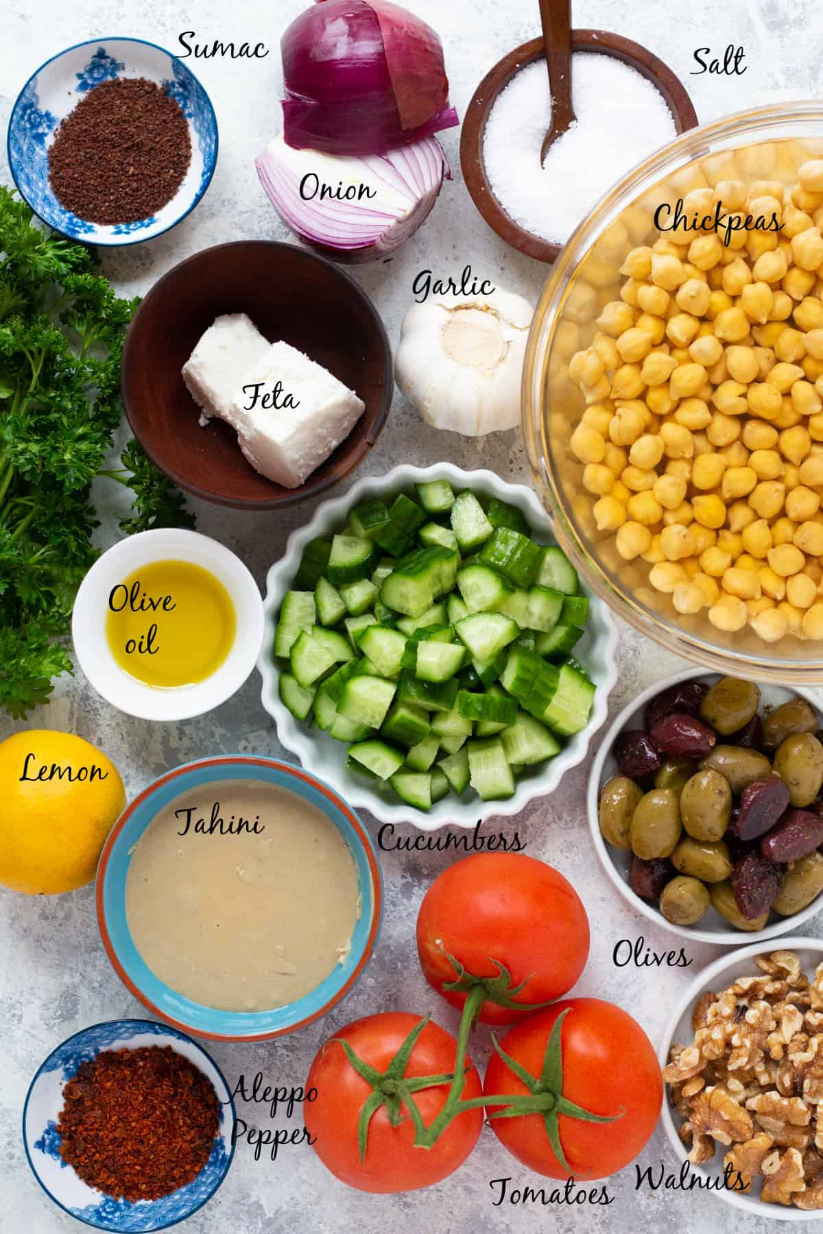 For this recipe you need hummus, feta, onion, sumac, olives, cucumber, olive oil, lemon, garlic, tomato and herbs.