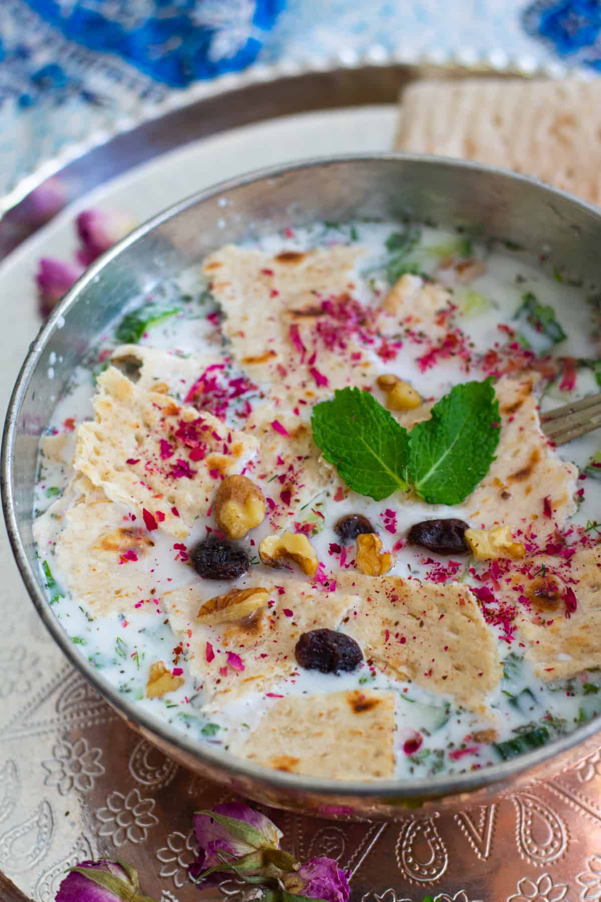 A bowl of abdoogh khiar on a tray.