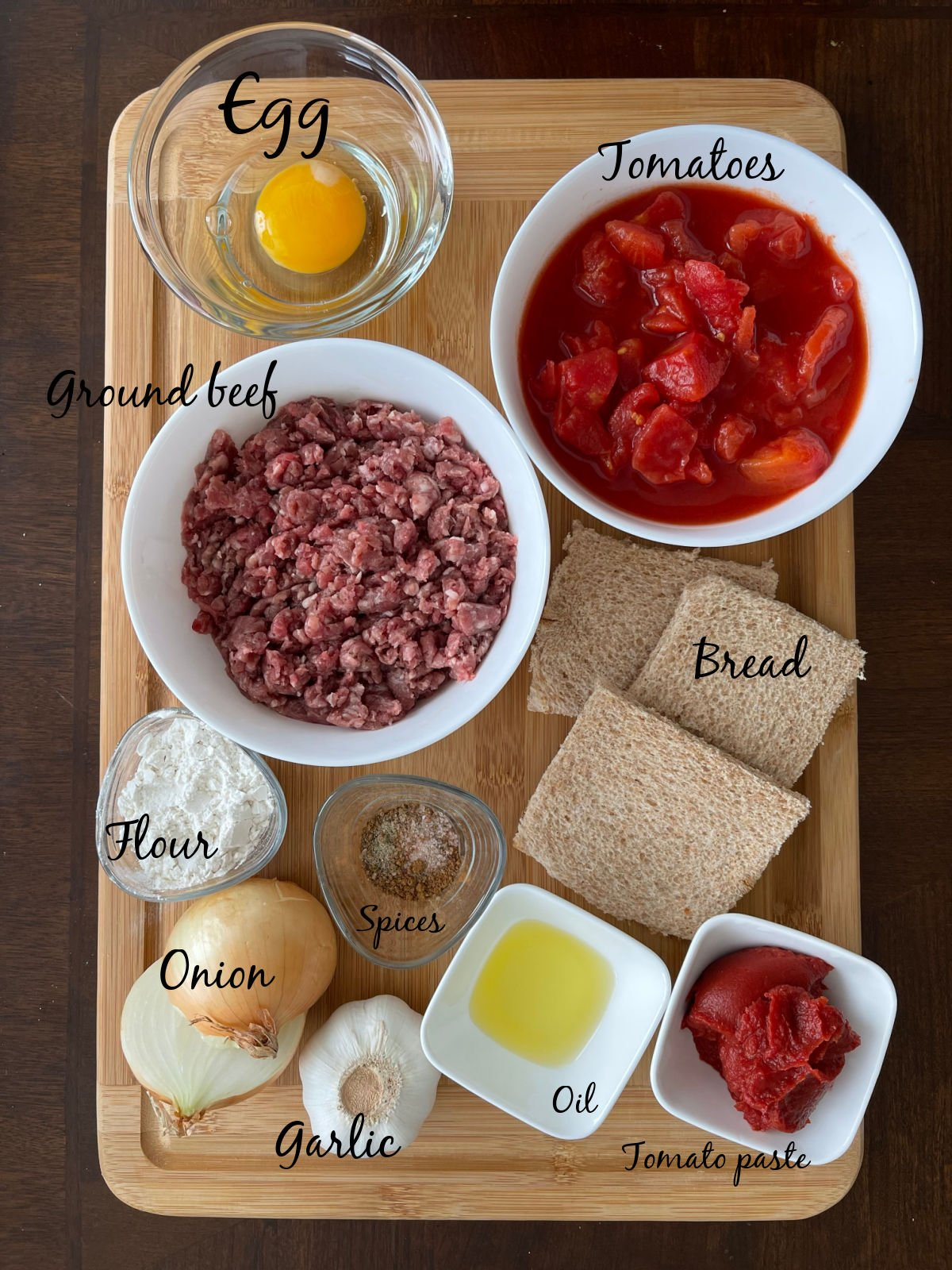 To make this recipe you need ground beef, spices, bread, tomato paste, tomatoes, flour and onion.